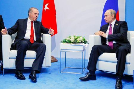Russian President Putin listens to Turkish President Erdogan during their meeting at the G-20 summit in Hamburg