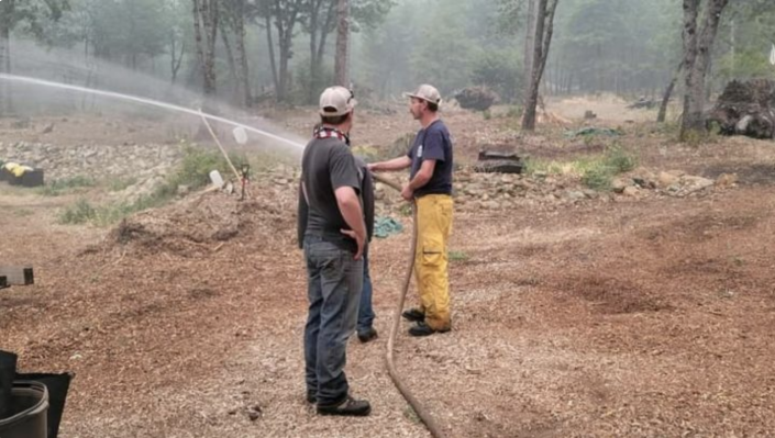 Taylorsville, CA brothers, Cody and Clancy Pearce, with the help of their family member, neighbor, Travis Bloxham, use water tenders to moisturize properties in the event the wildfires affect their homes. (Brad Underwood/GoFundMe)