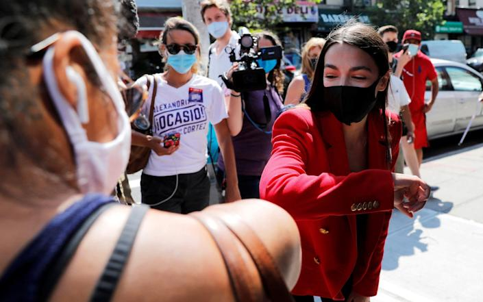 U.S. Rep. Alexandria Ocasio-Cortez (D-NY) wore a mask as she campaigned in Queens during Democratic congressional primary election in New York - Reuters