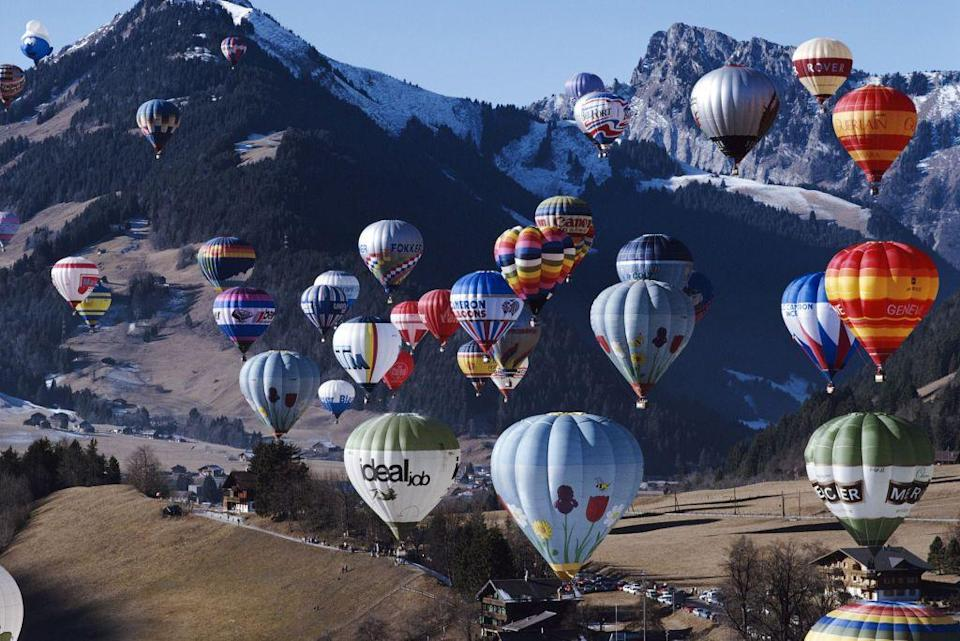 """<p>Switzerland is known for great skiing, but also for the <a href=""""https://www.chateau-doex.ch/en/P1152/international-hot-air-balloon-festival"""" rel=""""nofollow noopener"""" target=""""_blank"""" data-ylk=""""slk:International Hot Air Balloon Festival"""" class=""""link rapid-noclick-resp"""">International Hot Air Balloon Festival</a> held in Chateau d'Oex. </p>"""