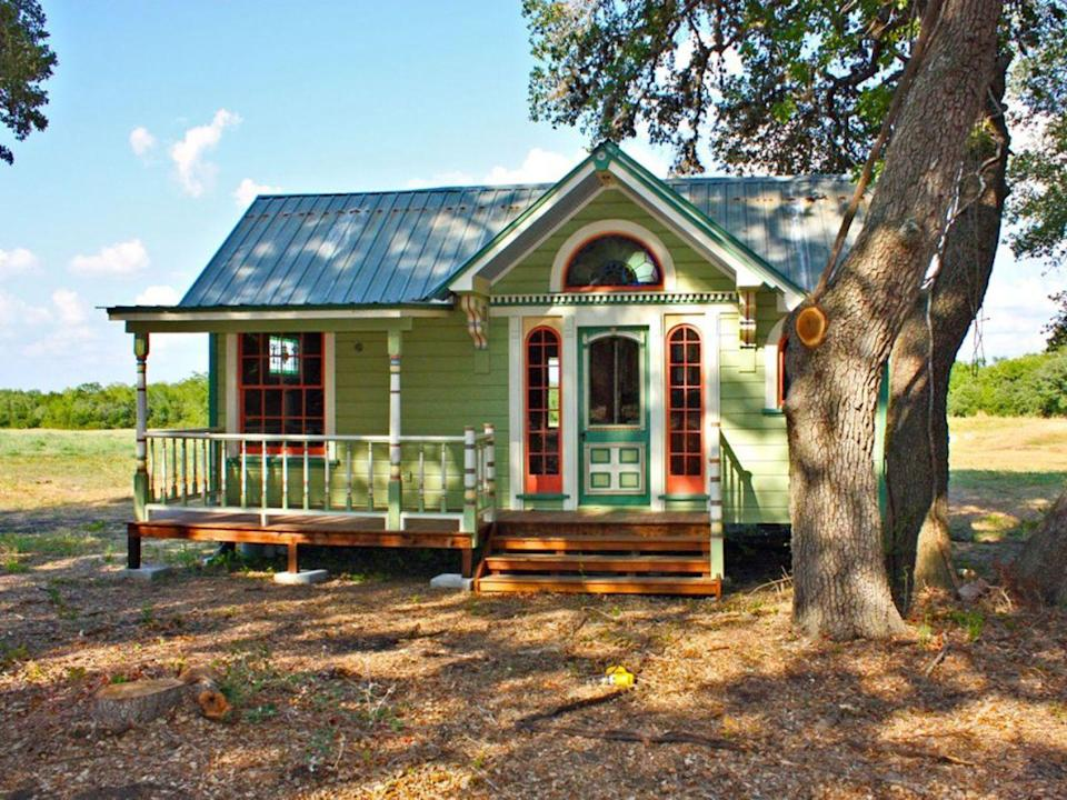 """<p>Painted with six colors, The Painted Lady is an intricately designed micro farmhouse in Round Top, Texas, from <a href=""""http://tinytexashouses.com/"""" rel=""""nofollow noopener"""" target=""""_blank"""" data-ylk=""""slk:Tiny Texas Houses"""" class=""""link rapid-noclick-resp"""">Tiny Texas Houses</a>. With a Victorian style exterior, the interior measures 12- by 26-feet and features a built-in couch, full kitchen, Murphy bed, sleeping loft, and bathroom with a glassed-in shower with a river rock floor. The home is 99 percent pure salvage, including the beams, floor joists, studs, windows, doors, and interior and exterior skins.</p>"""