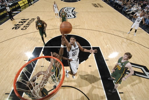 SAN ANTONIO, TX - APRIL 8: Tim Duncan #21 of the San Antonio Spurs goes to the basket during the game against the Utah Jazz at the AT&T Center on April 8, 2012 in San Antonio, Texas