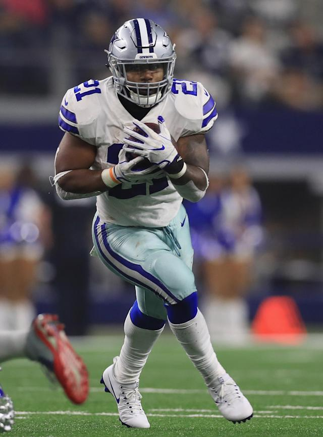(FILES) This file photo taken on September 09, 2017 shows Ezekiel Elliott #21 of the Dallas Cowboys running the ball against the New York Giants at AT&T Stadium in Arlington, Texas. A US judge on September 18, 2017 rejected an appeal by the National Football League seeking to overturn an injunction obtained by Ezekiel Elliott which has allowed the Dallas Cowboys running back to delay his six-game suspension. Elliott has been left free to play ever since obtaining the injunction against his suspension for a domestic violence case. (AFP Photo/RONALD MARTINEZ)