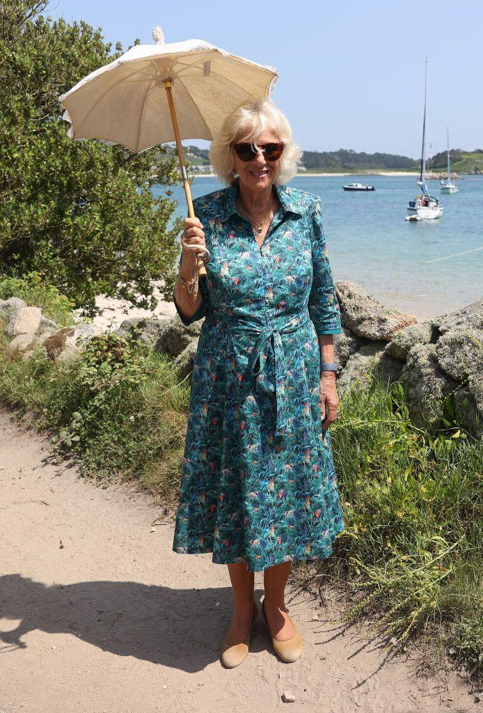 <p>Camilla looked ready for summer vacation on a recent trip to the Isles of Scilly off the coast of Cornwall. Spot the toucans on her tropical printed dress! </p>