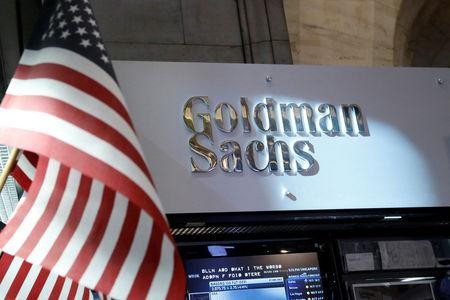 FILE PHOTO: A view of the Goldman Sachs stall on the floor of the New York Stock Exchange July 16, 2013. REUTERS/Brendan McDermid/File Photo