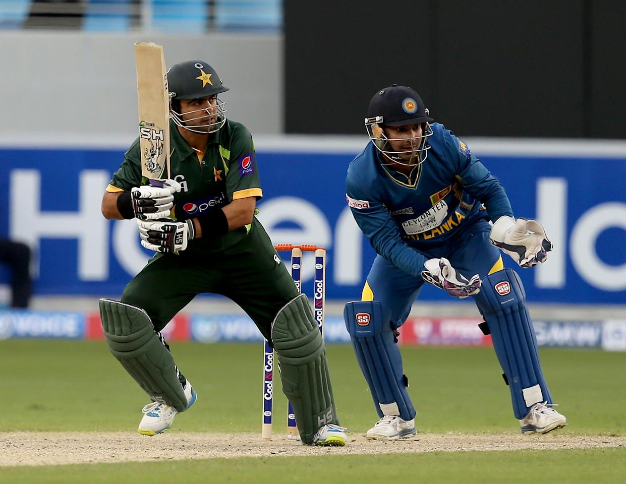 DUBAI, UNITED ARAB EMIRATES - DECEMBER 20:  Ahmed Shahzad of Pakistan bats during the second One-Day International (ODI ) match between Sri Lanka and Pakistan at the Dubai Sports City Cricket Stadium on December 20, 2013 in Dubai, United Arab Emirates.  (Photo by Francois Nel/Getty Images)