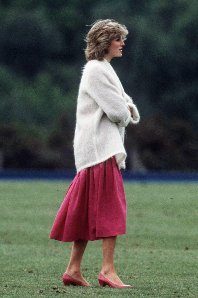 """<p>Sporting what we'd now call a """"boyfriend sweater,"""" Princess Diana makes effortless look chic.</p>"""