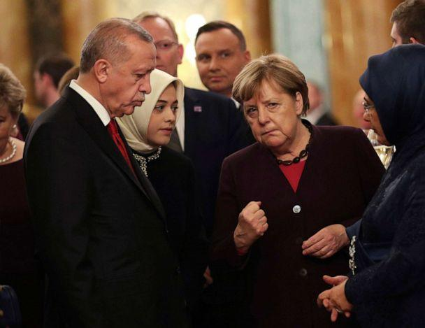 PHOTO: Turkish President Recep Tayyip Erdogan, left, speaking with Chancellor of Germany, Angela Merkel, during a formal reception for the heads of the NATO countries, at Buckingham palace in London, Dec. 3, 2019. (Yui Mok/Pool via AP)