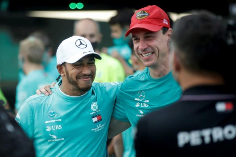 Double act: Lewis Hamilton with Toto Wolff on Sunday