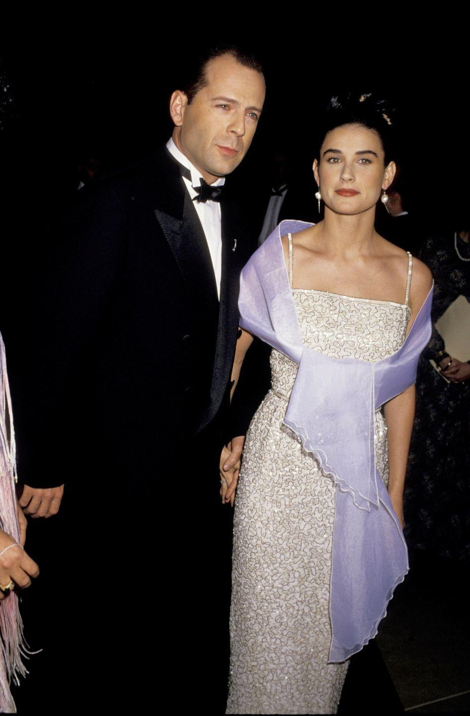 <p>There was a shift in the early '90s from over-the-top fashion to sleek, minimalist, and polished looks. Demi Moore was on trend with her spaghetti-strap, beaded gown and lilac shawl. </p>