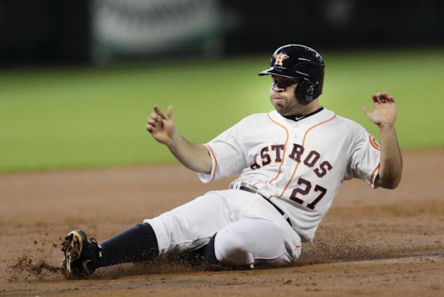 Houston Astros' Jose Altuve (27) slides into third base in the first inning of a baseball game against the Minnesota Twins, Monday, Sept. 2, 2013, in Houston. (AP Photo/Bob Levey)
