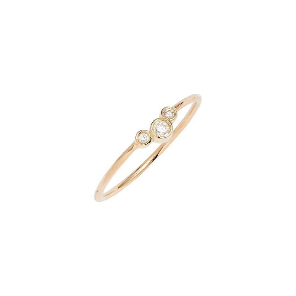 """This delicate band is perfect for young couples on the lookout for an affordable engagement ring. $325, Nordstrom. <a href=""""https://www.nordstrom.com/s/zoe-chicco-diamond-cluster-stackable-ring/4733698"""" rel=""""nofollow noopener"""" target=""""_blank"""" data-ylk=""""slk:Get it now!"""" class=""""link rapid-noclick-resp"""">Get it now!</a>"""