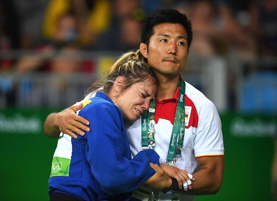 <p>Laura Gomez of Spain is comforted in defeat during the Women's -52kg Elimination round of 16 against Andreea Chitu of Romania on Day 2 of the Rio 2016 Olympic Games at Carioca Arena 2 on August 7, 2016 in Rio de Janeiro, Brazil. (Photo by Laurence Griffiths/Getty Images) </p>