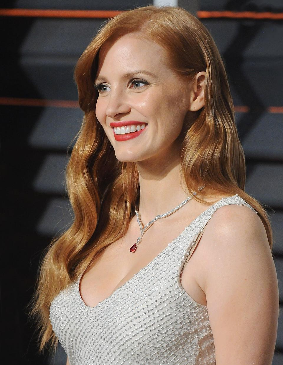 <p>Chastain wore her hair in long, cascading waves and had side-swept bangs for the <b>Vanity Fair</b> Oscars party in 2015.</p>