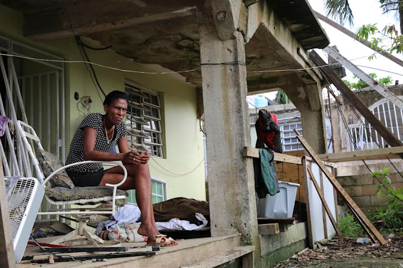 Juana Ferrera sits on the porch of her home in Valle Hill, Canóvanas, Puerto Rico.