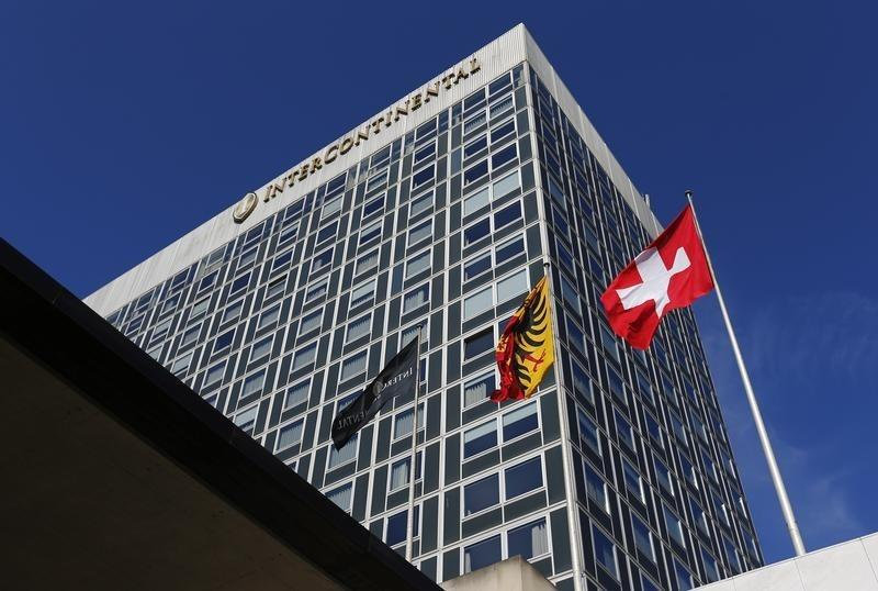 Flags are pictured in front of the Intercontinental hotel in Geneva