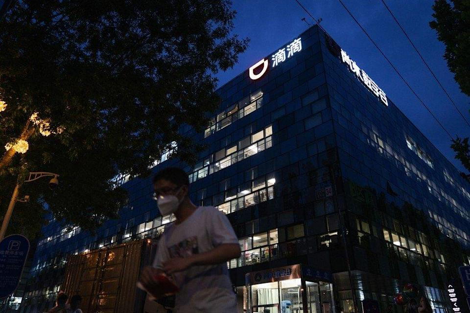 A pedestrian passes the Didi Global Inc in Beijing on Monday. Photo: Bloomberg