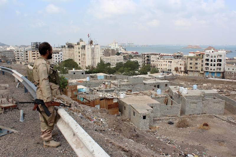 A fighter loyal to Yemen's President Abedrabbo Mansour Hadi looks on after they managed to take control of the port of the southern city of Aden, on January 4, 2016