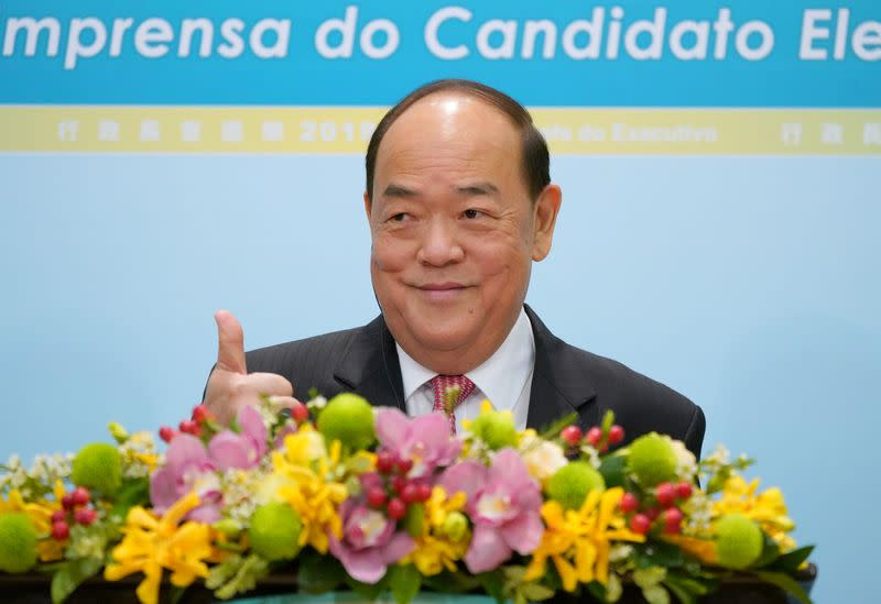 FILE PHOTO: Newly elected Macau Chief Executive Ho Iat Seng gestures during a news conference after winning the chief executive election in Macau
