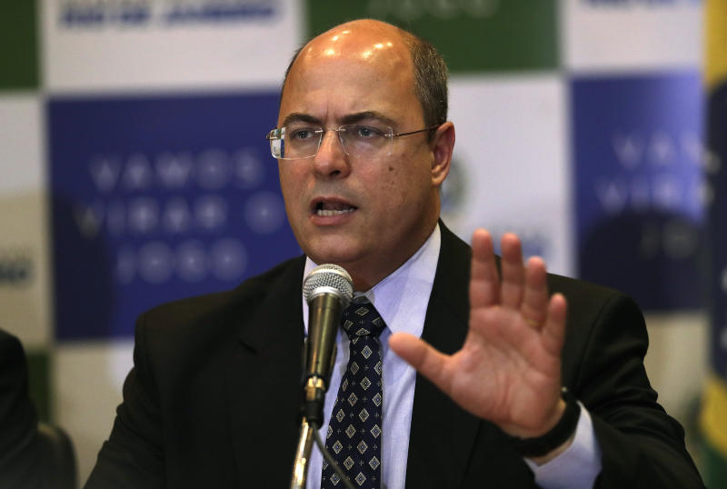 FILE - In this Sept. 23, 2019 file photo, Gov. Wilson Witzel speaks during a news conference in Rio de Janeiro, Brazil. Witzel said Tuesday, April 14, 2020, that he has tested positive for the new coronavirus. (AP Photo/Silvia Izquierdo, File)