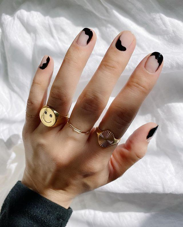 """<p>Not feeling an entirely black nail? Add squiggles—painted along the edges of your nails—to a basic nude manicure.</p><p><a href=""""https://www.instagram.com/p/B_kplvanWqQ/"""" rel=""""nofollow noopener"""" target=""""_blank"""" data-ylk=""""slk:See the original post on Instagram"""" class=""""link rapid-noclick-resp"""">See the original post on Instagram</a></p>"""