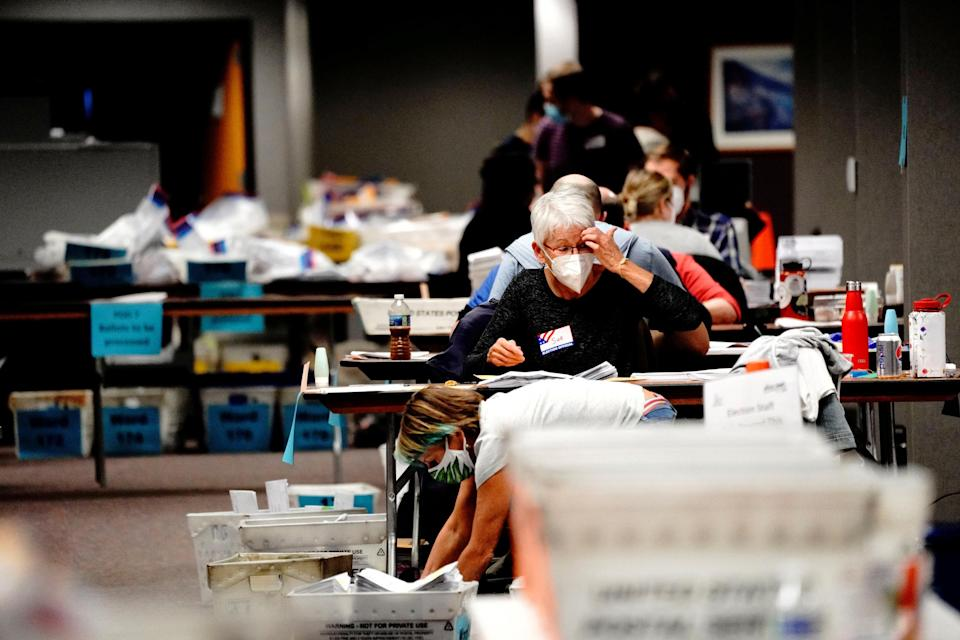 Image: Counting absentee ballots at Milwaukee Central Count (Bing Guan / Reuters)