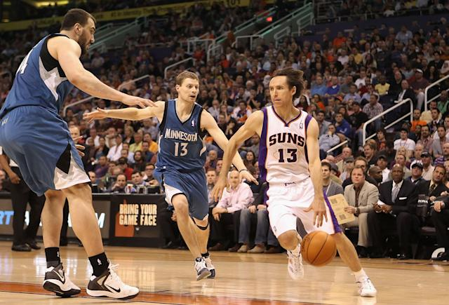 PHOENIX, AZ - MARCH 12: Steve Nash #13 of the Phoenix Suns handles the ball under pressure from Luke Ridnour #13 of the Minnesota Timberwolves during the NBA game at US Airways Center on March 12, 2012 in Phoenix, Arizona. The Timberwolves defeated the Suns 127-124. NOTE TO USER: User expressly acknowledges and agrees that, by downloading and or using this photograph, User is consenting to the terms and conditions of the Getty Images License Agreement. (Photo by Christian Petersen/Getty Images)