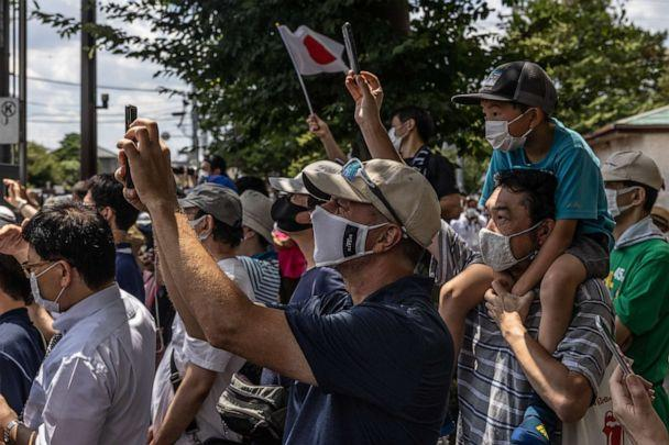 PHOTO: Spectators gather to watch the Women's Road Race as it leaves Musashinonomori Park on July 25, 2021 in Tokyo, Japan. (Carl Court/Getty Images)