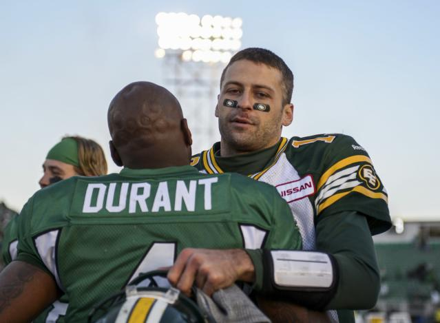 Saskatchewan Roughriders quarterback Darian Durant hugs Edmonton Eskimos quarterback Mike Reilly (R) at the end of their CFL football game in Regina, Saskatchewan October 12, 2013. The Saskatchewan Roughriders defeated the Edmonton Eskimos 14-9. REUTERS/Matt Smith (CANADA - Tags: SPORT FOOTBALL)