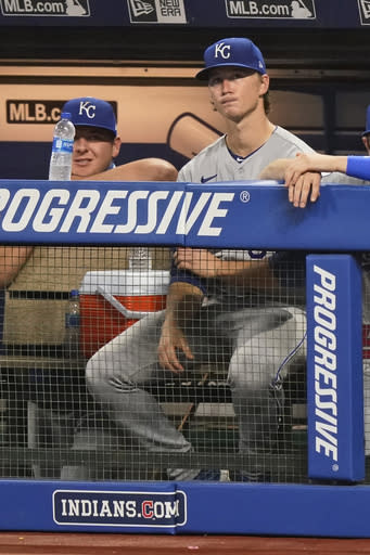 Kansas City Royals starting pitcher Brady Singer watches from the dugout in the ninth inning of the team's baseball game against the Cleveland Indians, Thursday, Sept. 10, 2020, in Cleveland. The Royals won 11-1. (AP Photo/Tony Dejak)