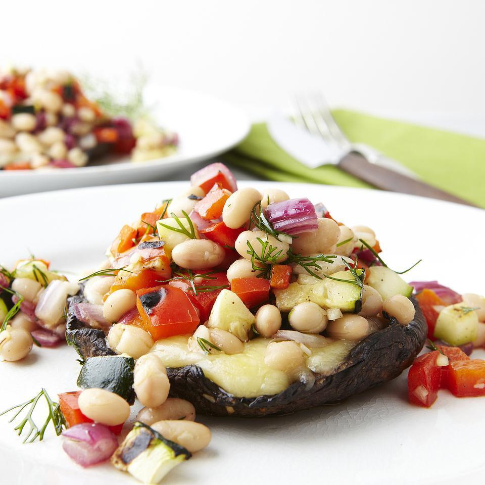 <p>This salad of grilled vegetables and beans tossed with lemon and dill tops grilled portobello mushrooms smothered in melted fontina cheese for a healthy vegetarian main course.</p>