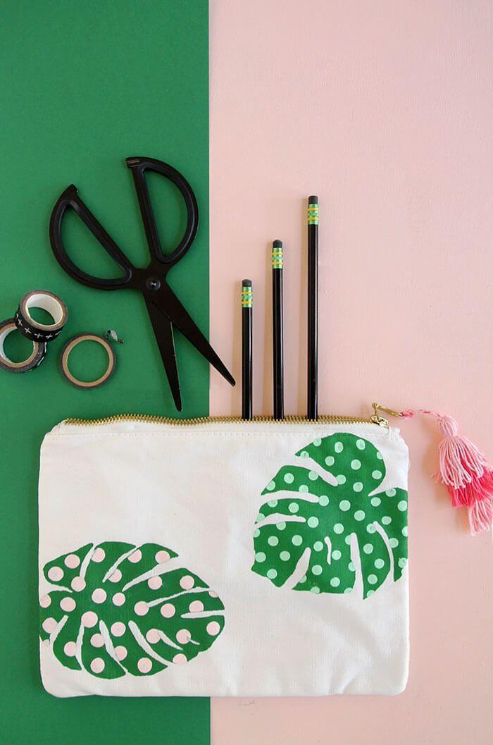 """<p>This one's for all the trendy teens out there. Add embellishments to a canvas pencil pouch to make it truly one-of-a-kind.</p><p><em><a href=""""https://persialou.com/paint-palm-leaf-pencil-pouch/"""" rel=""""nofollow noopener"""" target=""""_blank"""" data-ylk=""""slk:Get the tutorial at Persia Lou »"""" class=""""link rapid-noclick-resp"""">Get the tutorial at Persia Lou »</a></em> </p>"""