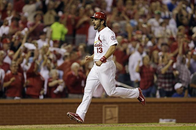 St. Louis Cardinals' Matt Carpenter celebrates as he scores on a double by Carlos Beltran during the third inning of Game 1 of the National League baseball championship series against the Los Angeles Dodgers Friday, Oct. 11, 2013, in St. Louis. (AP Photo/Jeff Roberson)