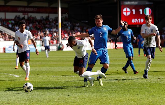 Soccer Football - UEFA European Under-17 Championship - Group A - England v Italy - The Banks's Stadium, Walsall, Britain - May 7, 2018 Italy's Alberto Barazzetta fouls England's Rayhaan Tulloch to concede a penalty Action Images via Reuters/Andrew Boyers