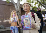 Britney Spears supporter Mona Montgomery of Glendale, Calif., demonstrates outside the Stanley Mosk Courthouse, Wednesday, Sept. 29, 2021, in Los Angeles. A Los Angeles judge will hear arguments at a hearing Wednesday over removing Spears' father from the conservatorship that controls her life and money and whether the legal arrangement should be ended altogether. (AP Photo/Chris Pizzello)