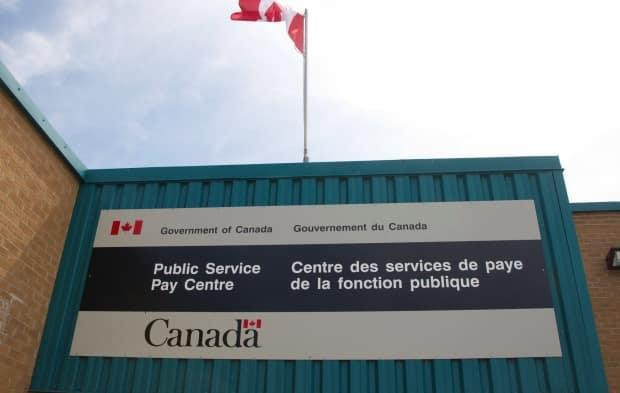 Due to an error made by the federal department's Public Service Pay Centre, about 1,000 employees have been paying into the wrong pension plan and some must now pay thousands back to the government.  (Ron Ward/Canadian Press - image credit)