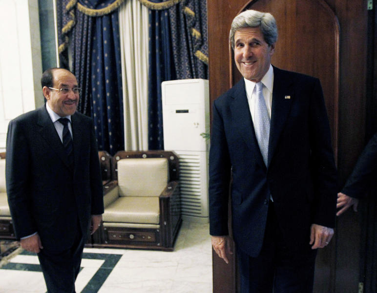 U.S. Secretary of State John Kerry, right, meets with Iraq's Prime Minister Nouri al-Maliki in Baghdad, Iraq, Sunday, March 24, 2013. Kerry made an unannounced visit to Iraq on Sunday and will urge al-Maliki to make sure Iranian flights over Iraq do not carry arms and fighters to Syria, a U.S. official said. (AP Photo/Jason Reed, Pool)
