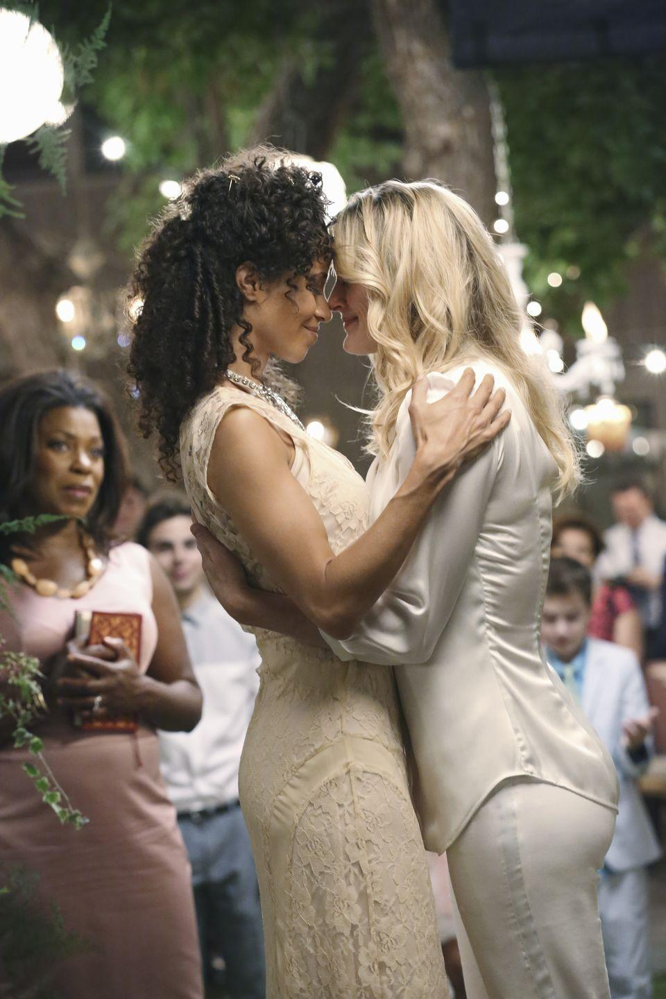 """<p>The season finale of ABC's <em>The Fosters</em> was the first show to feature a same-sex wedding since the overturning of DOMA, the Defense of Marriage Act. On the episode, appropriately named """"I do,"""" moms Stef and Lena tied the knot. According to <em>TV Guide</em>, who interviewed the show's executive producers, the episode was written and planned long before the historic decisions on Prop 8 and DOMA were made by the Supreme Court. </p><p>""""We knew the Supreme Court would likely make its decision before we shot [the episode],"""" <a href=""""https://www.tvguide.com/news/abc-familys-fosters-gay-wedding-1068890/#:~:text=ABC%20Family's%20The%20Fosters%20makes,landmark%20ruling%20on%20gay%20marriage."""" rel=""""nofollow noopener"""" target=""""_blank"""" data-ylk=""""slk:Executive Producer Peter Paige told TV Guide"""" class=""""link rapid-noclick-resp"""">Executive Producer Peter Paige told <em>TV Guide</em></a> in 2013. """"If they had ruled the other way we would have still gone ahead—only with an f--k you wedding! But because the Court did rule the way it did, it was an even more resonant celebration.""""</p>"""