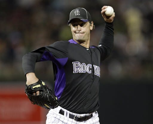 Colorado Rockies starting pitcher Jamie Moyer throws to the San Francisco Giants during the second inning of a spring training baseball game Thursday, March 22, 2012, in Scottsdale, Ariz. (AP Photo/Marcio Jose Sanchez)