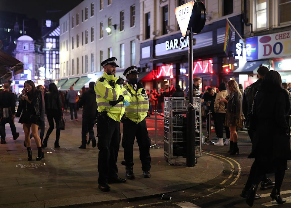 Police officers on patrol in Soho, central London, after a range of new restrictions to combat the rise in coronavirus cases came into place in England. (Photo by Yui Mok/PA Images via Getty Images)