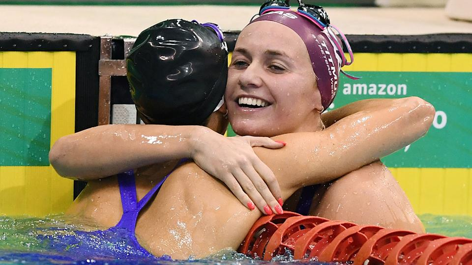 Ariarne Titmus, pictured here hugging Emma McKeon after the women's 200m freestyle final.