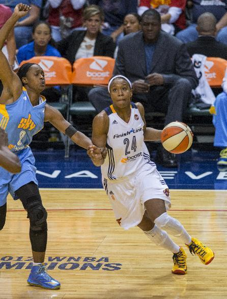 Indiana Fever forward Tamika Catchings (24) drives the ball around Chicago Sky forward Swin Cash (8) during the second half of Game 2 of the WNBA basketball Eastern Conference semifinal series, Sunday, Sept. 22, 2013, in Indianapolis. The Fever defeated Sky 79-57, winning the best-of-three series to advance to the Eastern Conference finals. (AP Photo/Doug McSchooler)