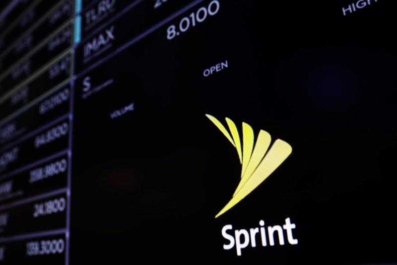A screen shows a Sprint logo above the floor of the New York Stock Exchange shortly before the opening bell in New York