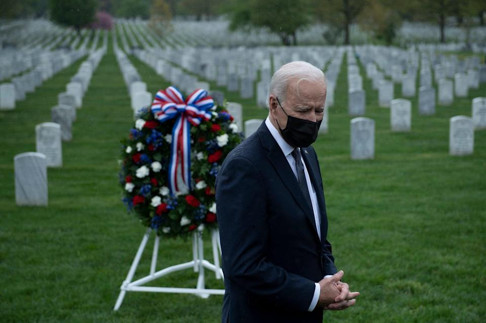 US President Joe Biden speaks to the press at Arlington National Cemetery's section 60, where many of those killed serving in Afghanistan are buried, April 14, 2021, in Arlington, Virginia. - President Joe Biden announced it's