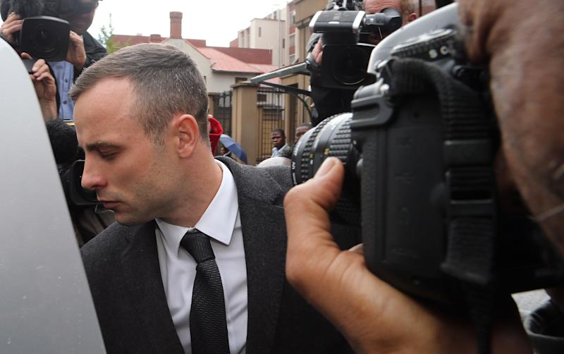 Oscar Pistorius leaves the high court in Pretoria, South Africa, Monday, April 14, 2014. Pistorius is charged with murder for the shooting death of his girlfriend, Reeva Steenkamp, on Valentines Day in 2013. (AP Photo/Themba Hadebe)