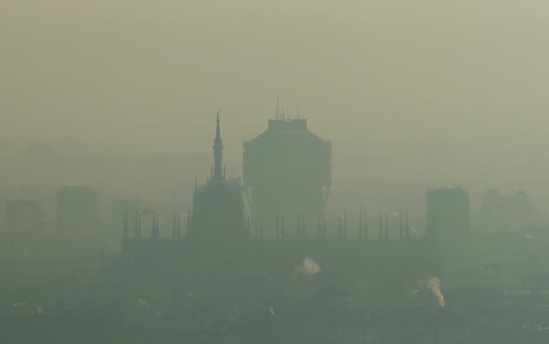 The profile of Milan's Duomo cathedral, Italy, is seen through the smog that hovers over the city, Tuesday, Dec. 29, 2015. The lack of rain and winds has brought pollution levels in Italy's business capital to exceed levels considered healthy for more than 30 straight days, prompting officials to ban private cars from 10 a.m. until 4 p.m. from Monday, Dec. 28 through Wednesday Dec. 30. (AP Photo/Antonio Calanni)