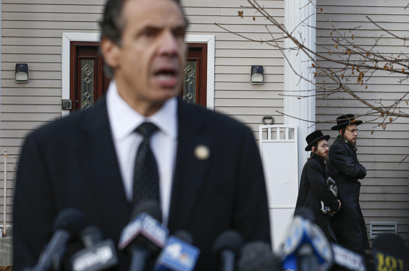New York Governor Andrew Cuomo speaks to the media outside the home of Rabbi Chaim Rottenberg in Monsey, New York on Dec. 29, 2019. | Kena Betancur—AFP/Getty Images)