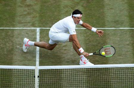 Tennis - Wimbledon - All England Lawn Tennis and Croquet Club, London, Britain - July 11, 2018 Canada's Milos Raonic in action during his quarter final match against John Isner of the U.S. REUTERS/Andrew Boyers