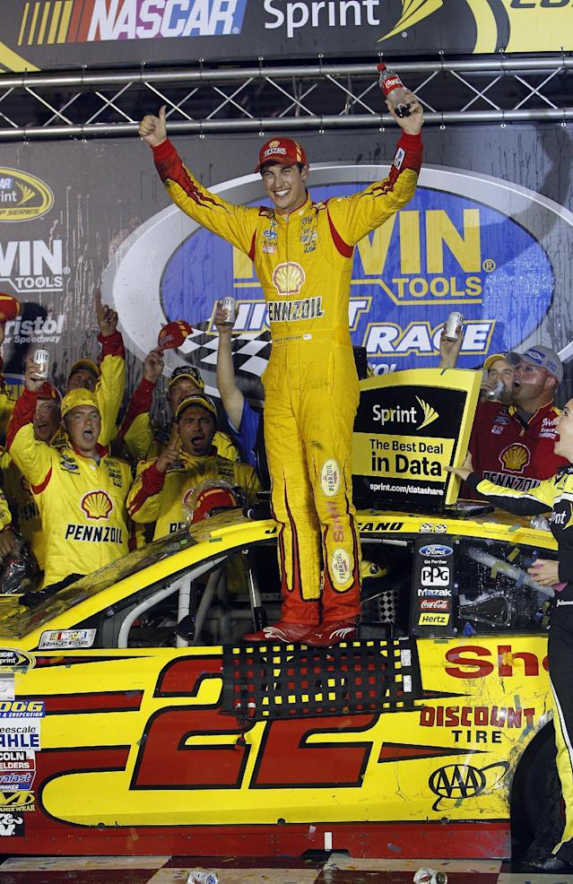 Joey Logano celebrates winning a NASCAR Sprint Cup Series auto race at Bristol Motor Speedway on Saturday, Aug. 23, 2014, in Bristol, Tenn. (AP Photo/Wade Payne)