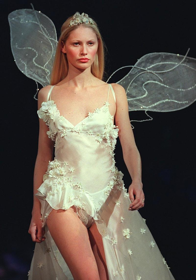 A model wearing a silk handkerchief and a satin thong at the 1999 Victoria's Secret Fashion Show in New York.